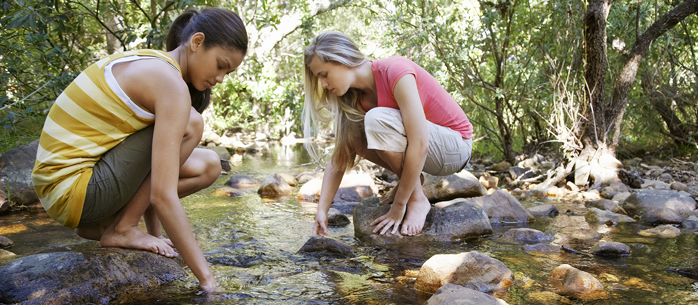 teen-girls-in-creek_shutterstock